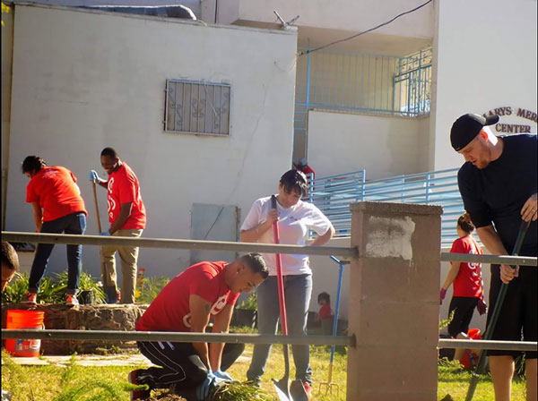 courtesy photo  Dozens of volunteers from Target's Distribution Center in Rialto helped with repairs at Mary's Mercy Center in San Bernardino.