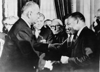 LBJ_and_Dr._King_after_signing_Civil_Rights_Act_of_1964_t580