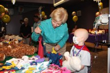 courtesy photo  Desert Guild board member Debbie Casden helped Caden pick out the Spiderman costume for his bear.