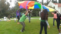 "courtesy photo/boys and girls club&lt;br /&gt;&lt;br /&gt;&lt;br /&gt;&lt;br /&gt;&lt;br /&gt;&lt;br /&gt;&lt;br /&gt;&lt;br /&gt;&lt;br /&gt;&lt;br /&gt;<br /> Kids and Starbucks volunteers play ""parachute"" at the Boys &amp; Girls Clubs of Greater Redlands-Riverside's annual Spring Fest at the Burrage Mansion in Redlands April 24."