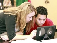 Edith Issakhanian, a Project SOL instructor, helping Bryan Lima understand the math assignment in front of him.