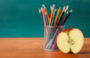 Teacher, desk, apple.