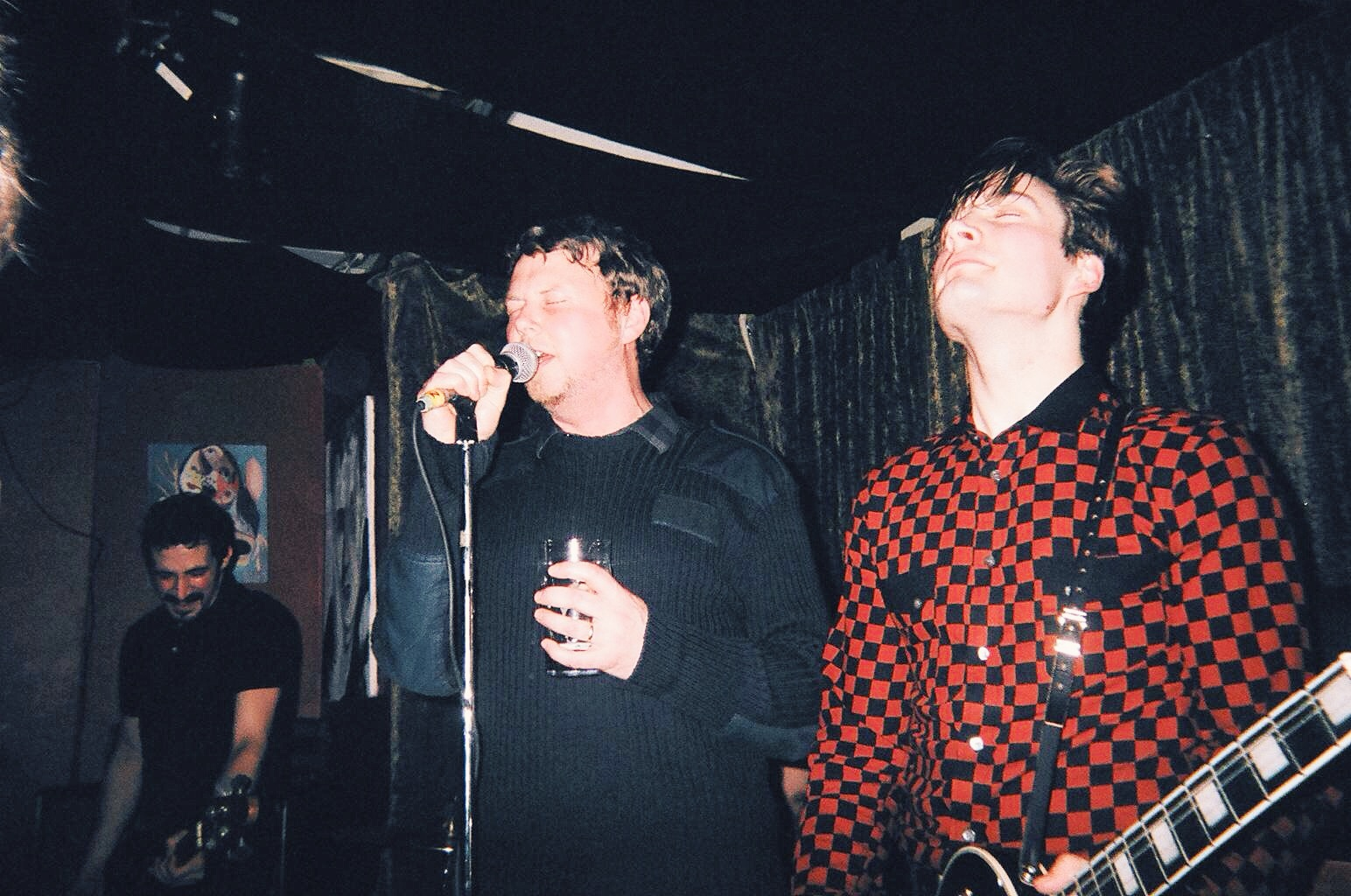 Casbah owner Brodie Schwendiman onstage with The Dirty Nil. Photo by Steph Dubik. Taken on disposable camera.
