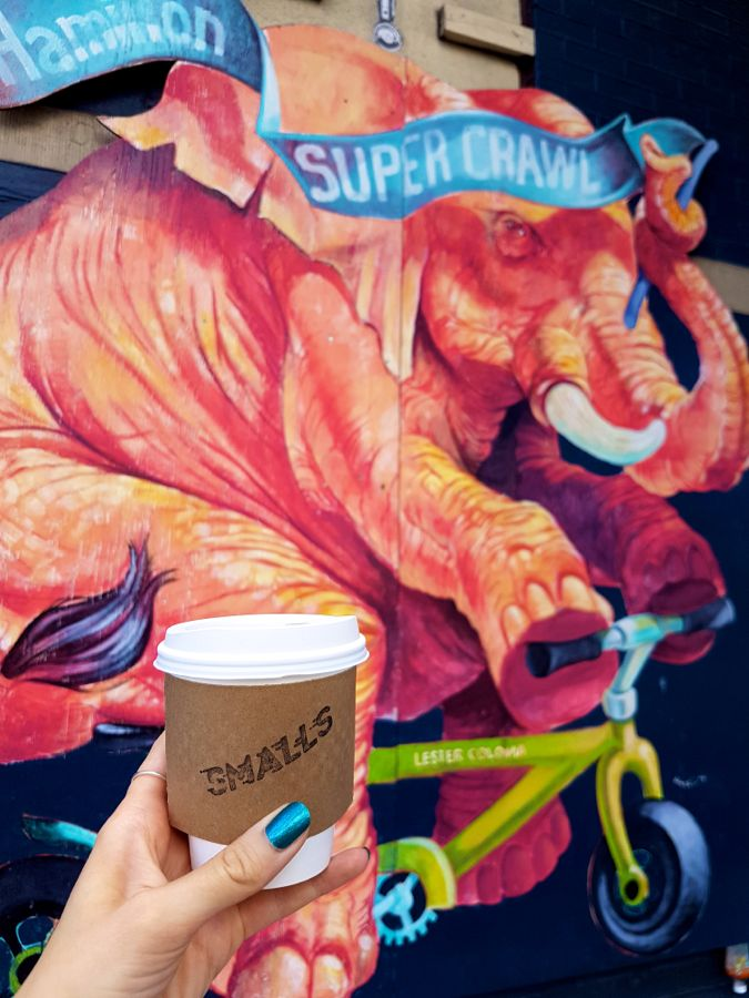Smalls Coffee on Cannon by Lester Coloma mural. Photo by Kristin Archer