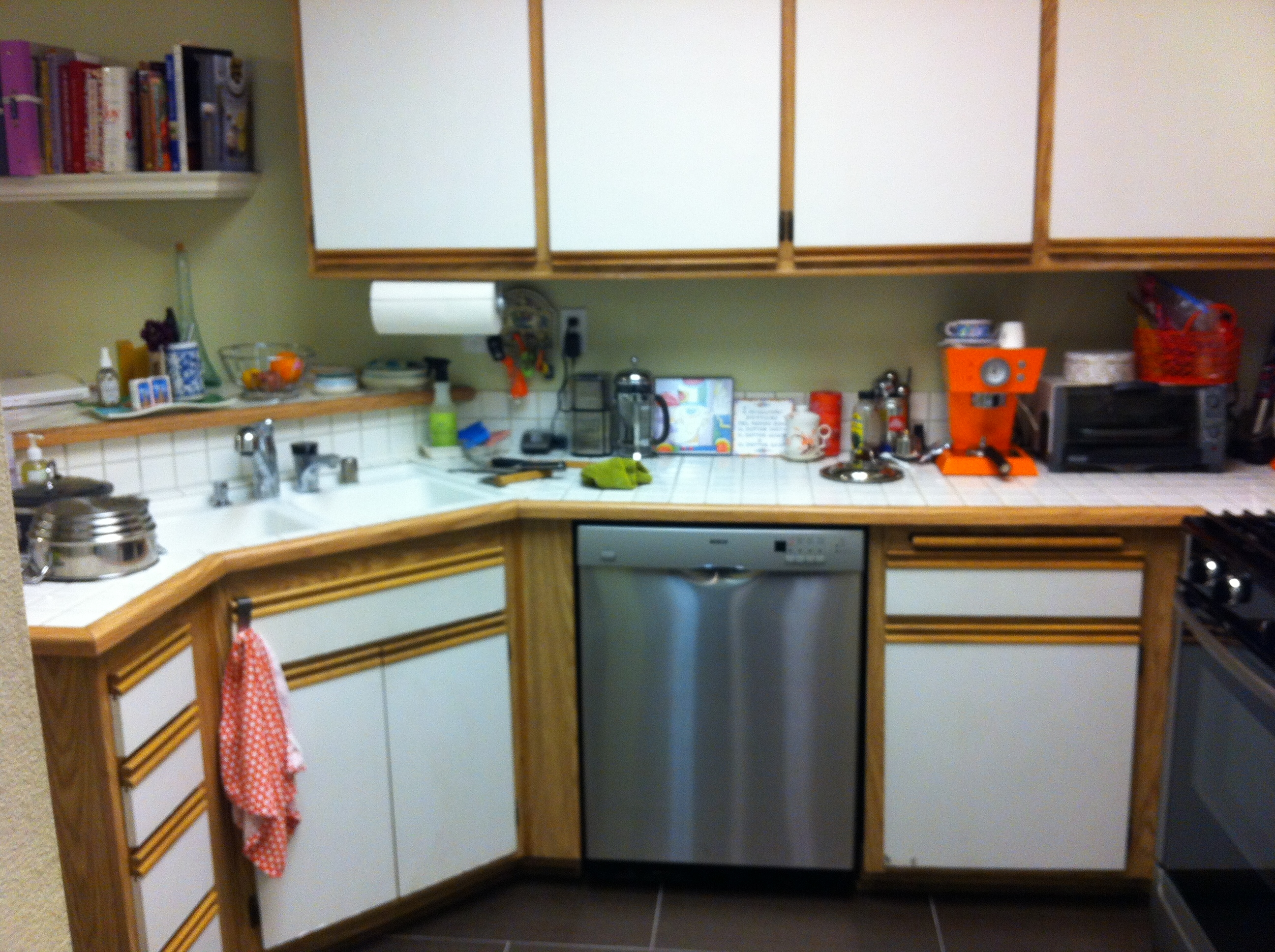 how ikdo transformed an old fashioned white kitchen old kitchen cabinets White cabinets with thick wood frames made the kitchen look outdated