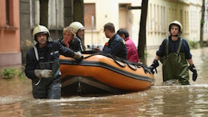 Firefighters stack sandbags on the banks of the Danube river in the historic city center on June 3, 2013 in Zeitz, Germany. Heavy rains are pounding southern and eastern Germany, causing wide-spread flooding and ruining crops. At least two people are missing and feared dead in what is evolving into the most serious flood levels since the so-called 100-year flood of 2002. Portions of Austria and the Czech Republic are also inundated.