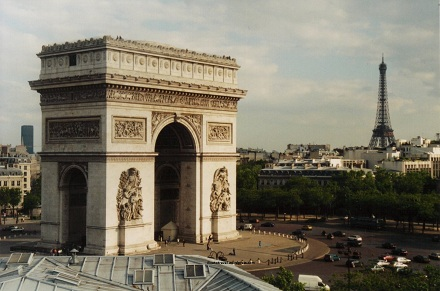 Arc de Triomphe and Eiffel Tower in Paris, France by day