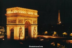 Arc de Triomphe and Eiffel Tower in Paris, France at night