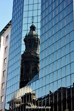 Great summary of the juxtaposition of old and new in Santiago: the Cathedral and a building across the street