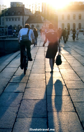 Couple headed home at sunset in Oslo, Norway