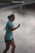 Runner cooling off during the Peachtree Road Race in Atlanta