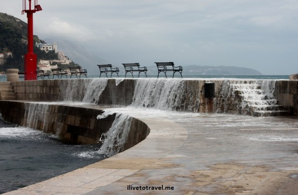 Waves crashing in Dubrovnik's sea walkway
