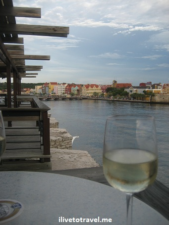 Wine as we enjoy the view of Punda from Otrobanda in Willemstad, Curacao