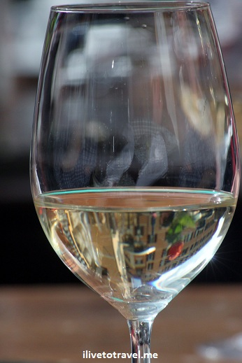 White wine from Italy with Campo de Fiore reflected