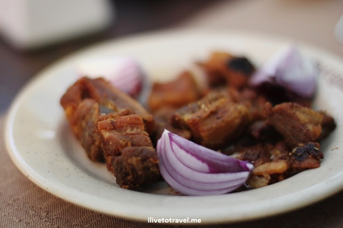 fried pork chunks, onions, Romanian food