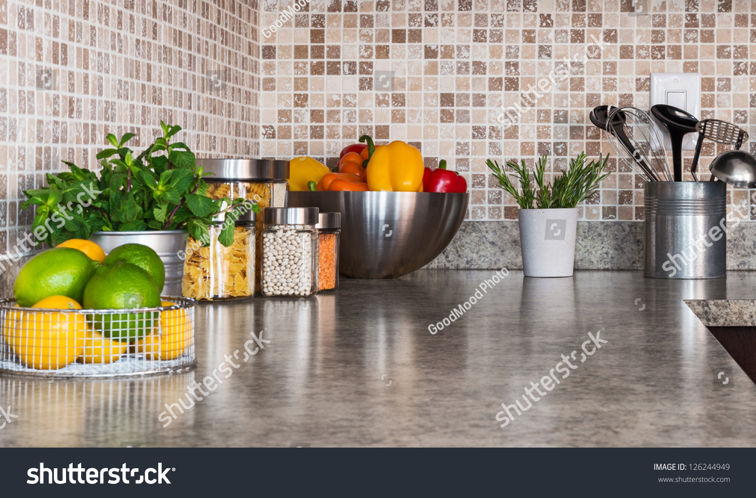 stock photo modern kitchen countertop with food ingredients and green herbs 126244949