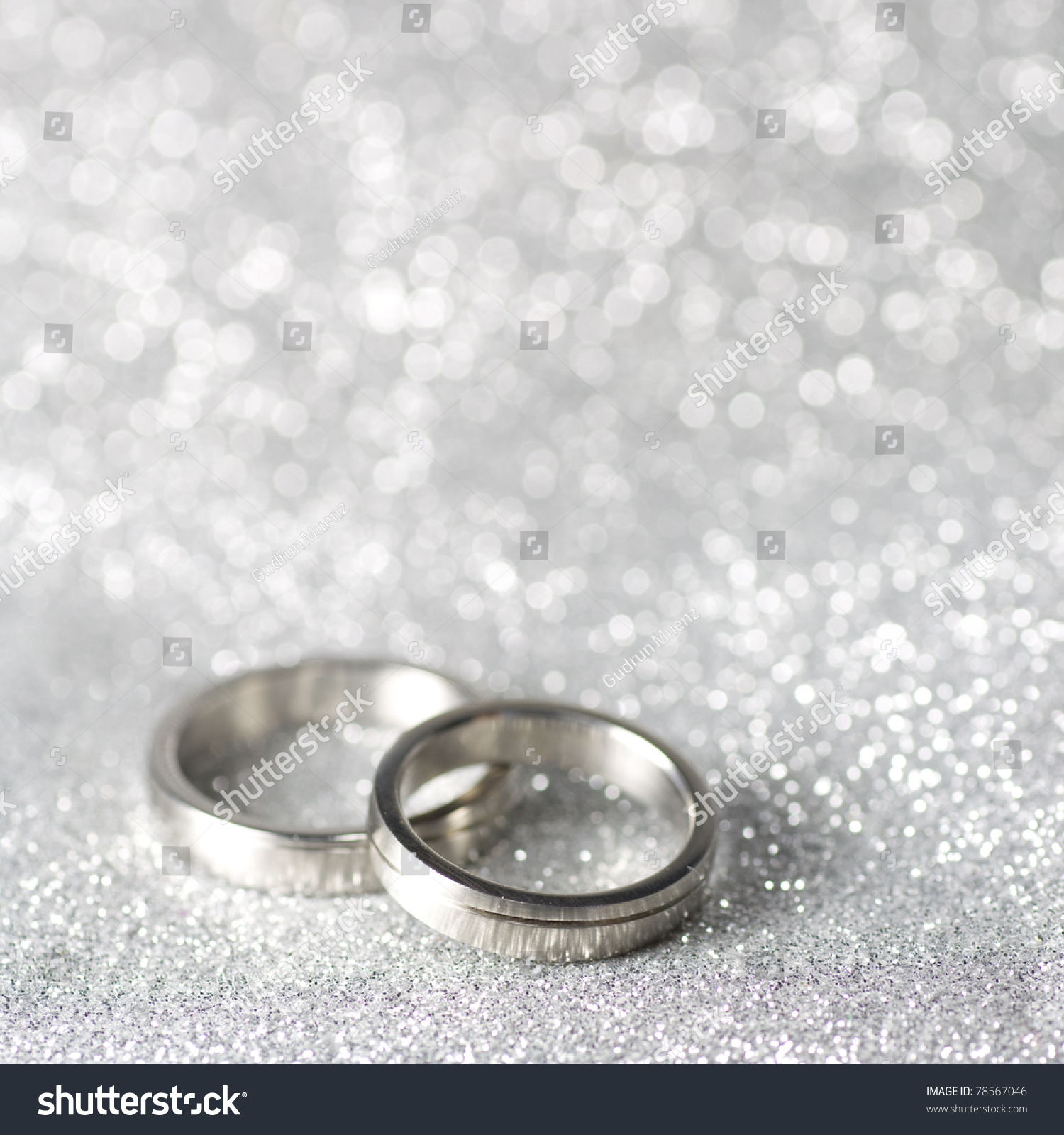 wedding rings on silver background silver wedding rings Wedding rings on a silver background