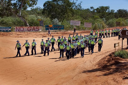 Police chaperone equipment taken to the  gas hub site at James Price Point, the development of which is opposed by locals.