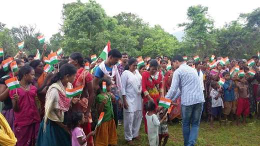 Villagers attend the hoisting of the tricolour