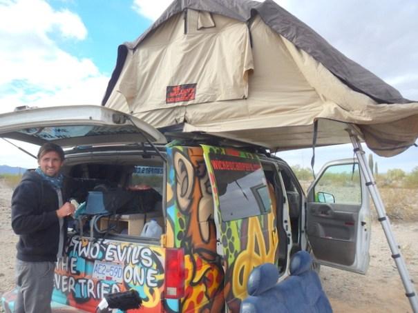 Michele in back of their van.