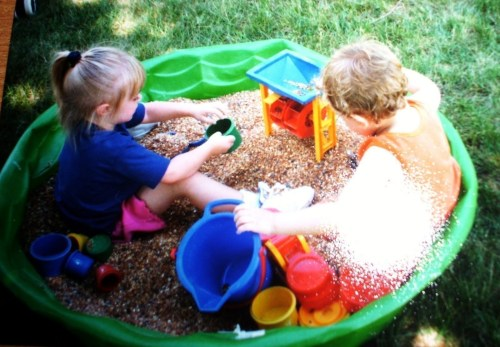 Medium Of Two Kids In A Sandbox