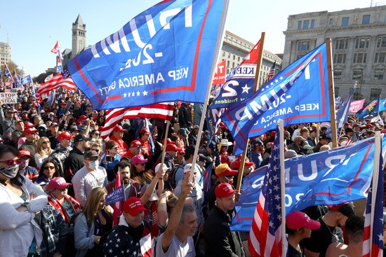 "WASHINGTON, DC - NOVEMBER 14: People participate in the ""Million MAGA March†from Freedom Plaza to the Supreme Court, on November 14, 2020 in Washington, DC. Supporters of U.S. President Donald Trump marching to protest the outcome of the 2020 presidential election. (Photo by Tasos Katopodis/Getty Images)"