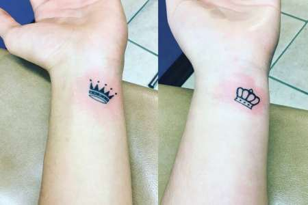 crown tattoo design on wrist
