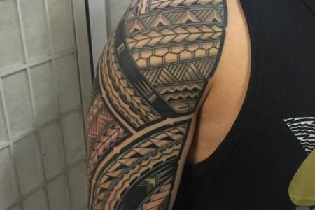 tribal flame half sleeve tattoo