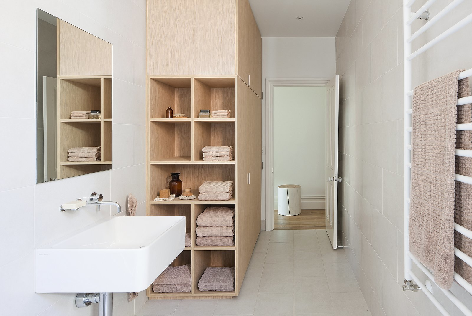 Showy This Home Organic Feel Wardrobe Which Gives Bathroom A Warm Melbourne By Design Duo Kathryn Robson Susie Cohen Has Deep Nook Shelves At One End bathroom Bathroom Racks And Shelves