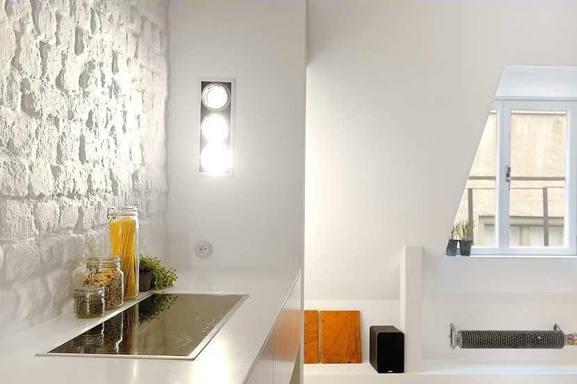 Monoambiente con decoraci n moderna y escandinava for Como ubicar la heladera en la cocina