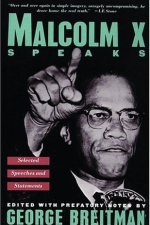 Reading books Malcolm X Speaks: Selected Speeches and Statements