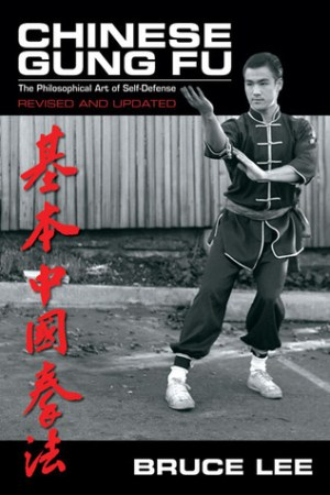 Reading books Chinese Gung Fu: The Philosophical Art of Self-Defense