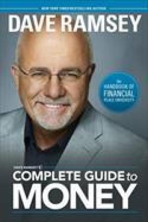Reading books Dave Ramsey's Complete Guide to Money: The Handbook of Financial Peace University