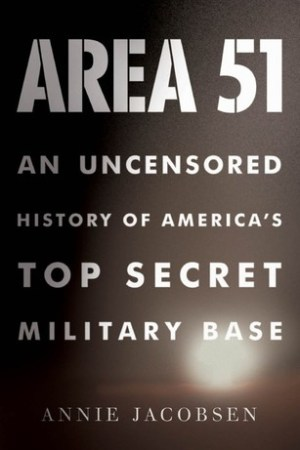 Reading books Area 51: An Uncensored History of America's Top Secret Military Base