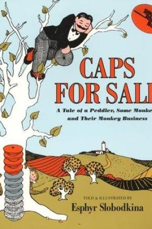 Reading books Caps for Sale: A Tale of a Peddler, Some Monkeys and Their Monkey Business