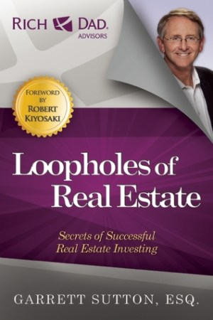 Reading books Loopholes of Real Estate