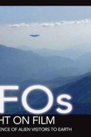 Reading books UFOs Caught on Film: Amazing Evidence of Alien Visitors to Earth