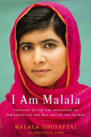 Reading books I Am Malala: The Story of the Girl Who Stood Up for Education and Was Shot by the Taliban