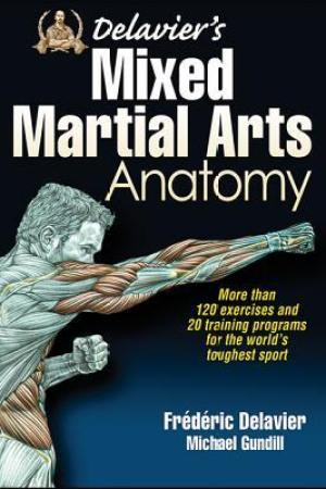 Reading books Delavier's Mixed Martial Arts Anatomy