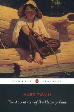 Reading books The Adventures of Huckleberry Finn