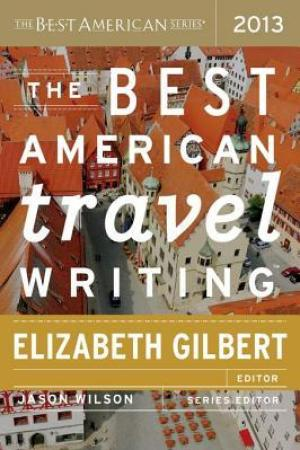 Reading books The Best American Travel Writing 2013