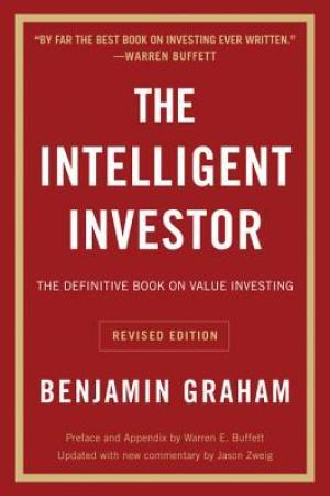 Reading books The Intelligent Investor (Collins Business Essentials)