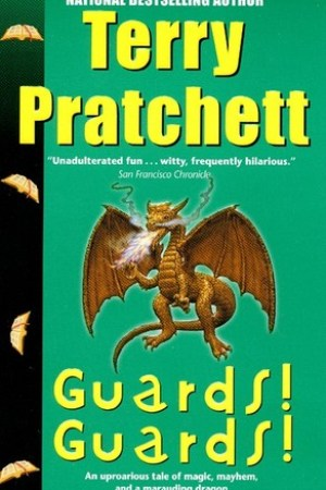 Reading books Guards! Guards! (Discworld, #8)
