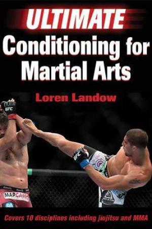 Reading books Ultimate Conditioning for Martial Arts