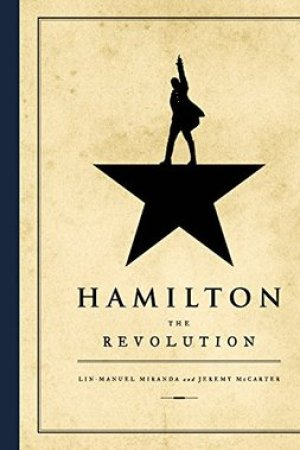 Reading books Hamilton: The Revolution