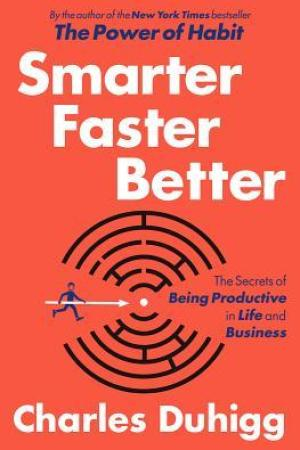 Reading books Smarter Faster Better: The Secrets of Being Productive in Life and Business