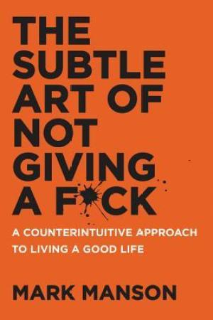 Reading books The Subtle Art of Not Giving a F*ck: A Counterintuitive Approach to Living a Good Life