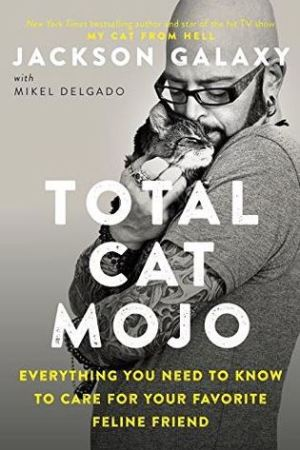 Reading books Total Cat Mojo: Everything You Need to Know to Care for Your Favorite Feline Friend