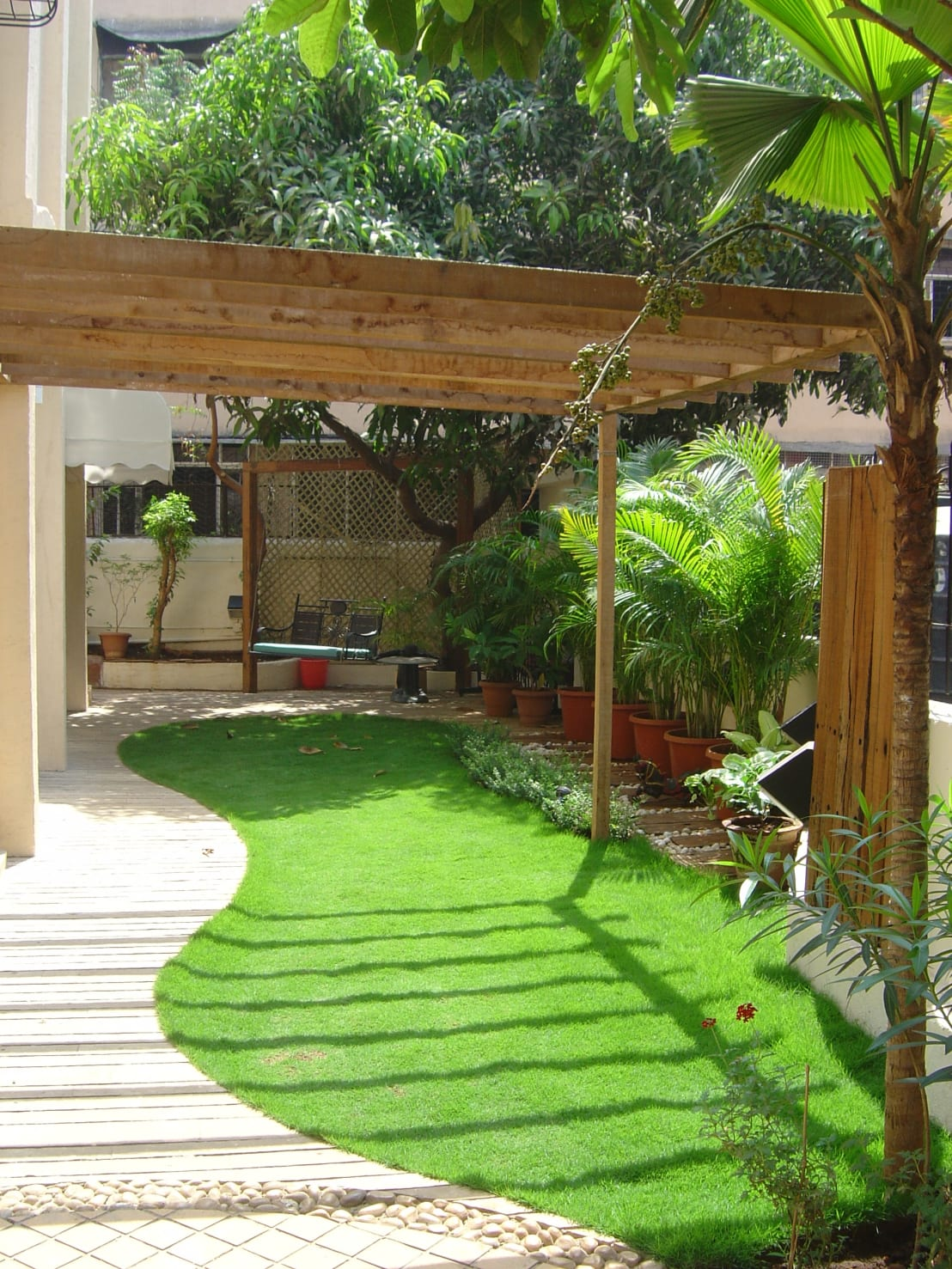 Enamour Tropical Garden By Land Design Landscape Architects Land Design Landscape Landscape Architects Mumbai Land Images Landscape Architecture Lawn Area outdoor Land Images Landscaping