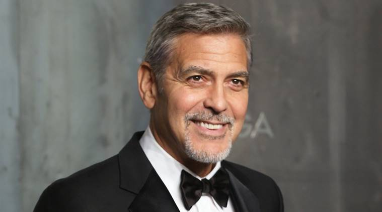 George Clooney limps on the airport runway after scooter crash   The     George clooney